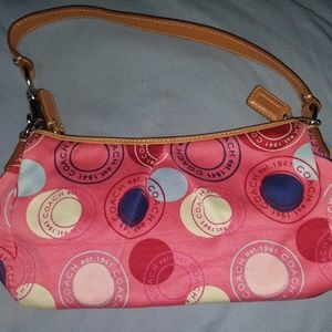 Coach purse pink with short strap so cute.